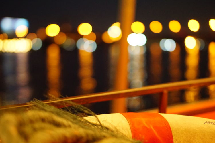 On a boat 🚣 No People Close-up Night Night Lights On A Boat Safety Torus Rope Dark Background Bokeh Bokeh Photography Bokeh Lights Bokeh Background Bokeh Bubbles Bokeh Light Warm Light Safety First! Feeling Safe River Reflections Neon Lights Urban Skyline River Beauty In Nature Landscape River View River Reflection Boatlife