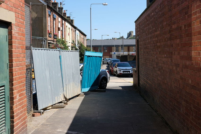 back alley in Scarborough Backalley Alleyways Architecture Brick Wall Building Exterior Built Structure Car City Corrugated Iron Day Land Vehicle Mode Of Transport No People Outdoors Sky Stationary Street The Way Forward Transportation