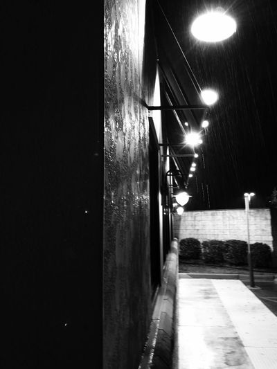 The texture of the building, the halos from the lights and falling rain summons forth a mysterious element.