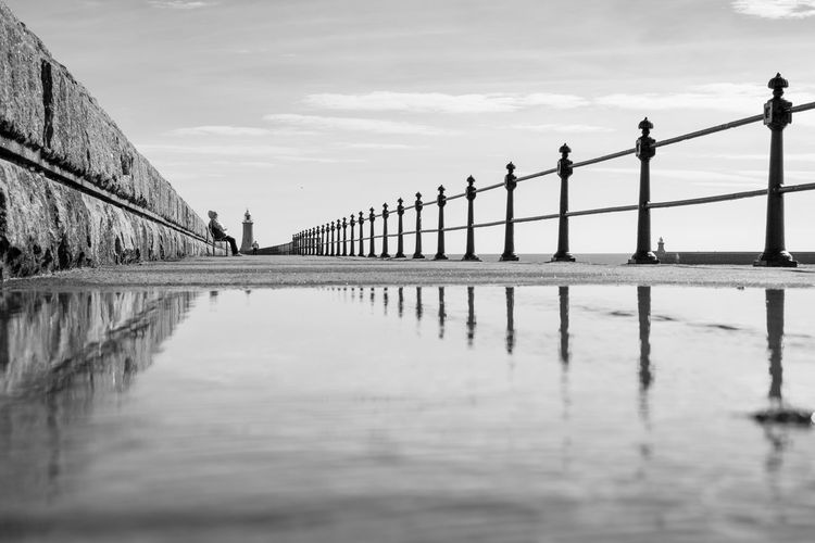 Tynemouth Pier Nikonphotography Northeast Nikon Perspective Perspectives Blackandwhite Photooftheday EyeEm Gallery Sky Water Cloud - Sky Built Structure Architecture Reflection Waterfront Nature Day Tranquility Tranquil Scene Railing
