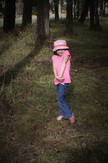 Full Length One Person Pink Color Childhood One Girl Only People Grass Outdoors Rubber Boot Nature Real People Low Section Day