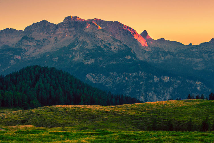 Scenic view of landscape and mountains during sunset
