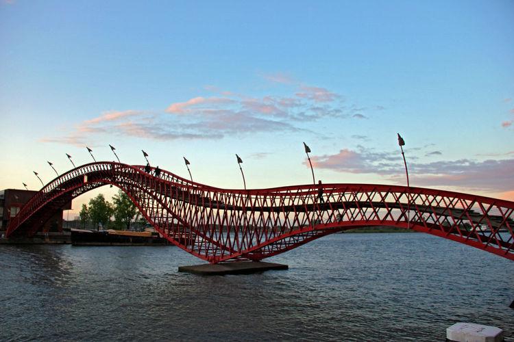 The Python bridge in Amsterdam Amsterdam Architecture Architecture_collection Blue Sky Bridge Python Bridge Red Red Bridge Your Amsterdam The Architect - 2016 EyeEm Awards