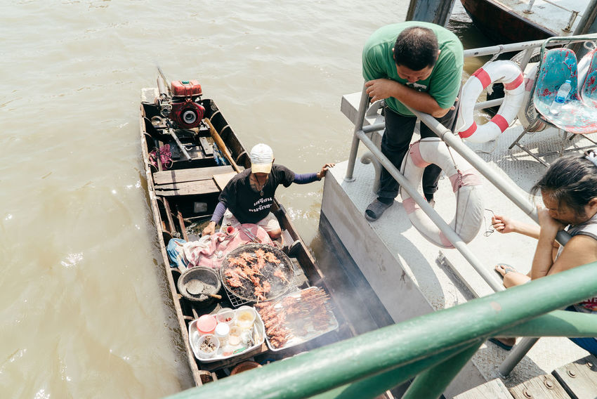 Food And Drink Adult Boat Day Food Food And Drink Food Sellers Food Store Freshness High Angle View Men Nautical Vessel Outdoors People Real People Water Waterfront Women