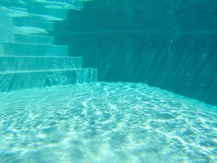 Steps In Turquoise Swimming Pool