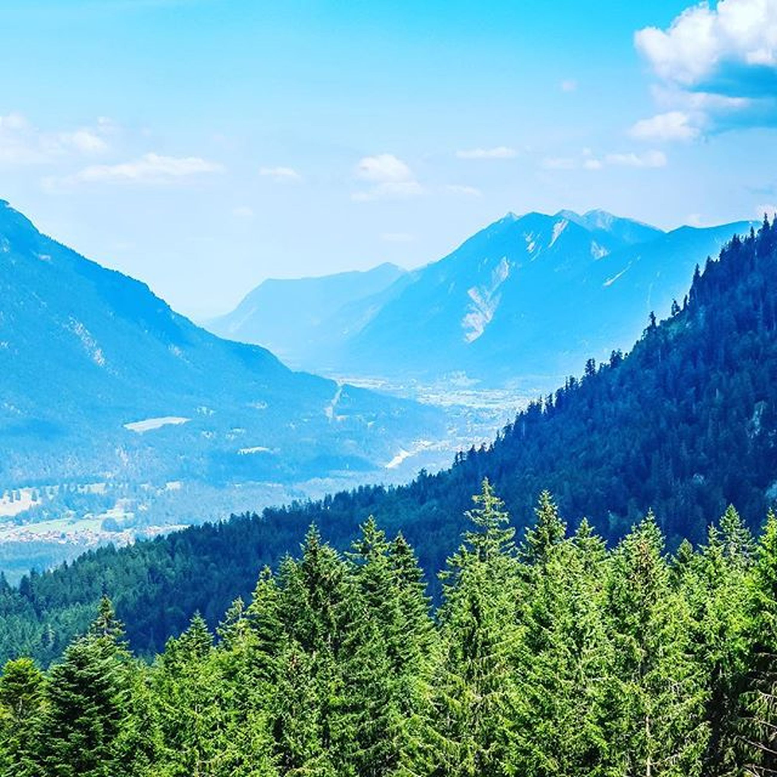 mountain, mountain range, tranquil scene, scenics, tranquility, beauty in nature, tree, sky, landscape, nature, growth, non-urban scene, idyllic, green color, valley, cloud - sky, cloud, day, outdoors, no people