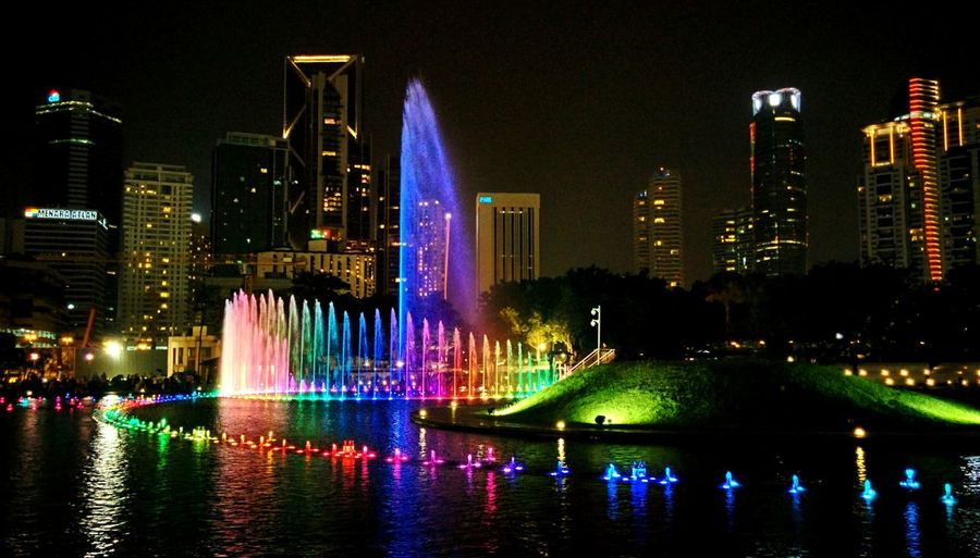 Colour Of Life Kuala Lumpur Klcc Lights Symphony Nightphotography Waterfountain Citynights,lights Coloursplash Nexus5photography Nexus5 Week On Eyeem Eyeemphoto Urbanscene Battle Of The Cities TakeoverContrast Traveling Home For The Holidays The City Light Minimalist Architecture