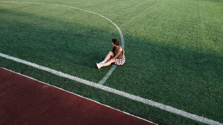 High Angle View Green Color Day Full Frame Grass Stadium Girl Lines EyeEm EyeEm Best Shots Young Women Real People EyeEm Gallery The Color Of Sport Fresh on Market 2016 Waiting Game