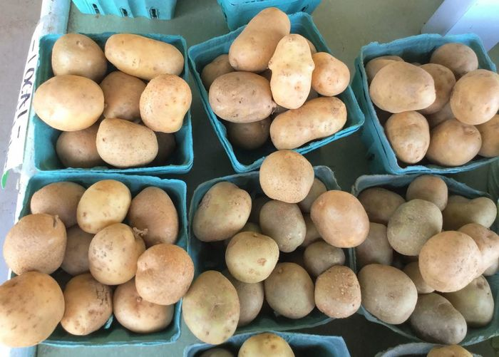 High angle view of potatoes for sale at market stall