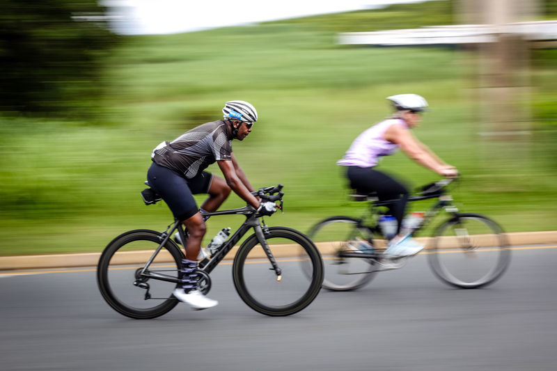 Tour Durban cycle race Sport Motion Two People Bicycle Men Blurred Motion Riding Ride Competition Activity Transportation Helmet Speed Sports Clothing Lifestyles Real People Full Length Side View Day Tour Durban Motion Blur Motion Photography