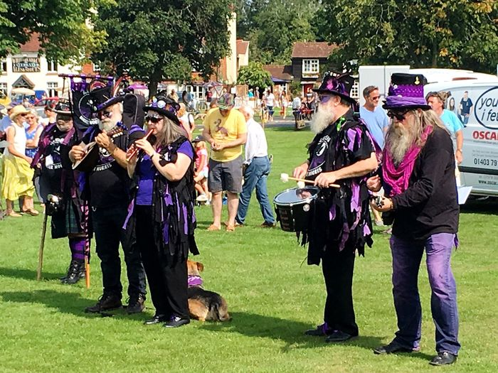 Morris Dancers Fete English Large Group Of People Togetherness Fun Adult Real People Day Leisure Activity People Outdoors Music Happiness Listening Full Length Women Community Men Grass Young Adult Crowd Adults Only Summer Exploratorium