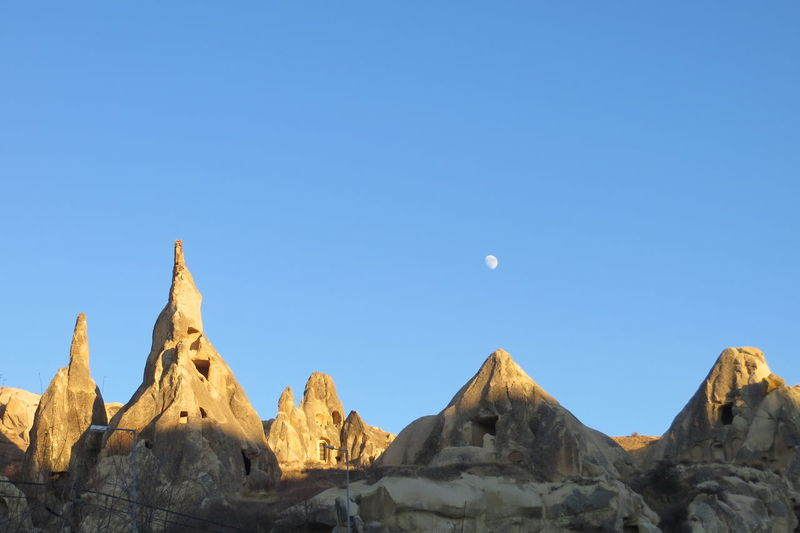 🇹🇷 Fairy caves and moon Bluesky Shadows & Lights Cappadocia Travelingtheworld  Travel Photography Instaturkey Goreme Open Air Museum National Park Nature Turkey Anatolia Caves Clear Sky Göreme Landscape Moon Rocky Mountains Sky Travel Destinations The Great Outdoors - 2018 EyeEm Awards