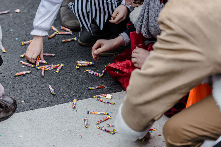High Angle View Of People Picking Candies From Street During Carnival