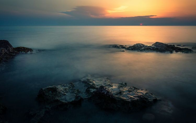 """""""We are like islands in the sea, separate on the surface but connected in the deep."""" William James Long Exposure Longexposurephotography Sunset Sunlight Sunrise Sea Rocks Cliffs Reflection No People Beauty In Nature Refraction Seascape Seaside Shore Seashore Seascape Photography Landscape Landscape_Collection Nikon Nikonphotography Nikon D3200 Nature Photography Salento Scenics"""