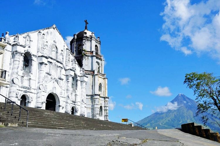 Architecture Travel Destinations Old Ruin History Blue Outdoors Mountain Sky Day City No People Church Mayon Volcano Daraga, Albay Philippines Volcanic Landscape Beauty In Nature Albay, Philippines Leisure Activity History Architecture Cityscape
