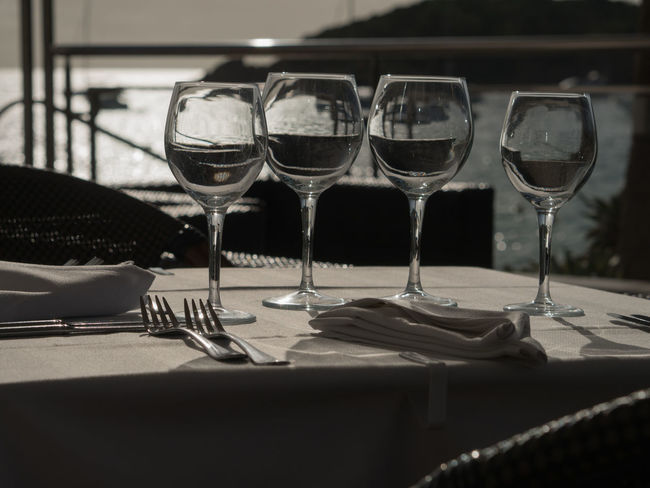 Absence Alcohol Business Dining Drink Drinking Glass Food Food And Drink Freshness Glass Glass - Material Household Equipment Indoors  No People Red Wine Refreshment Restaurant Setting Still Life Table Table Knife Transparent Wine Wineglass