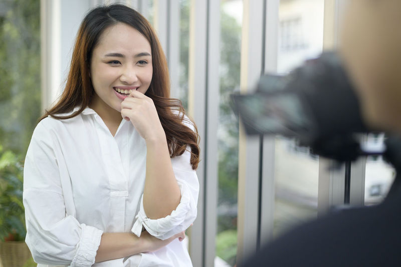 Smiling young woman looking away during interview