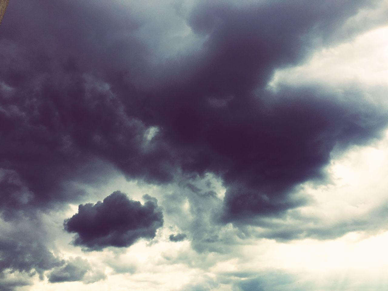 cloud - sky, nature, beauty in nature, low angle view, sky only, weather, sky, cloudscape, scenics, backgrounds, atmospheric mood, dramatic sky, majestic, tranquility, no people, storm cloud, idyllic, tranquil scene, outdoors, awe, day, full frame