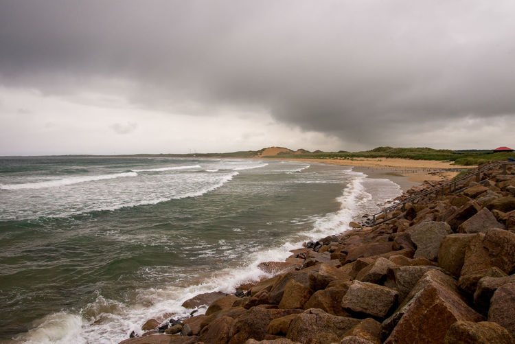 A view to a Fraserburgh beach and a coastline, north east Scotland, Great Britain Aberdeenshire Great Britain North East Place Scotland United Kingdom Bay Cloud - Sky Coast Fraserburgh Horizon Over Water Motion Ominous Outdoor Outdoors Power In Nature Rock Scenics - Nature Shore Storm Cloud Tourism Travel Destinations Visit Water Wave