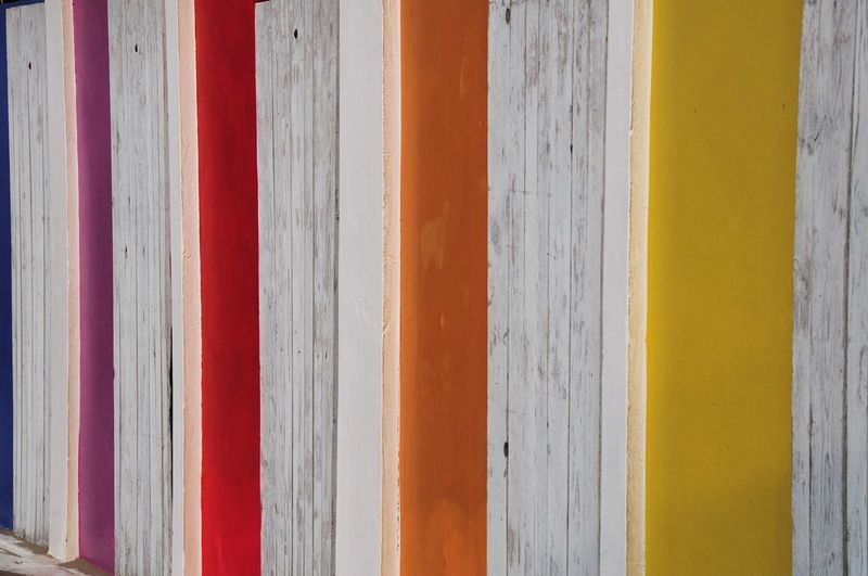Full frame shot of colorful patterned wooden wall
