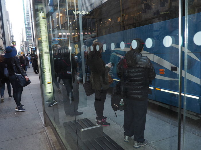 Architecture Blue Built Structure Bus Stop Casual Clothing City City Life Day Leisure Activity Lifestyles Medium Group Of People Men Modern Public Transportation Reflection Reflections See The World Through My Eyes See Thru See What I See See-thru Urban Lifestyle Urbanphotography