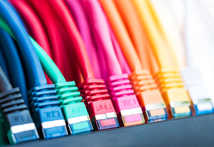 Colorful network cables connected to a switch Abundance Arrangement Blue Cat5 Cat6 Cat7 Choice Close-up Collection Colorful Colorful Life Connected Day Internet LAN# Multi Colored Network Network Cable Network Switch Networking Networking Event No People Still Life Switch Wifi