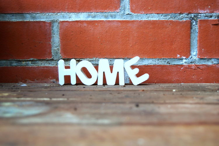 Surface Level Of Home Text By Brick Wall