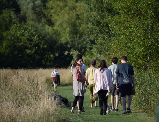 Hometime Grass Togetherness Medium Group Of People Rear View Walking Home Friendship Standing Group Of People Outdoors Field Day Tree Green Color Leisure Activity Growth Nature Real People Men Wiltshire UK Family Time Hot Days Wiltshire Countryside