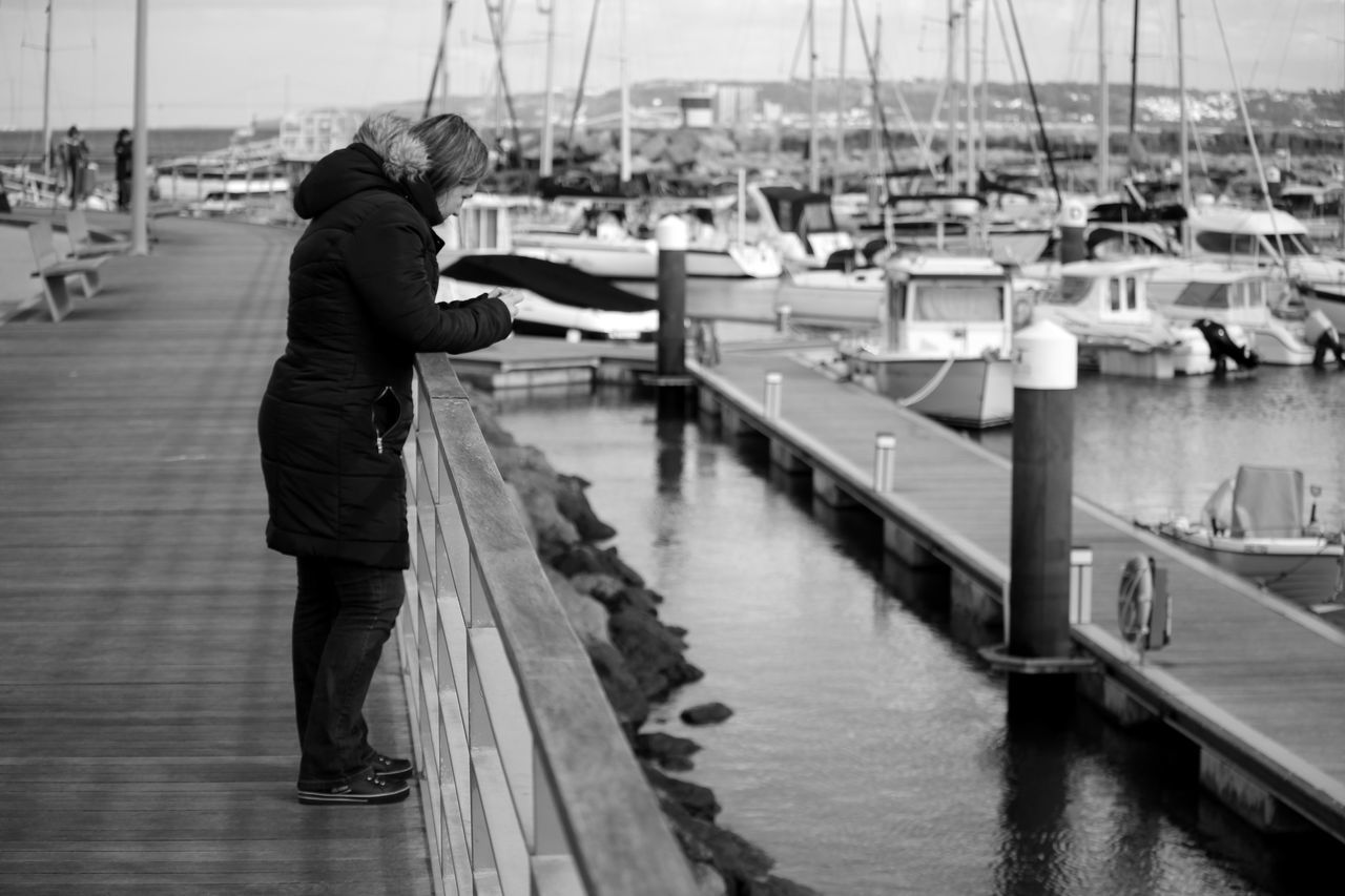nautical vessel, real people, water, transportation, moored, full length, harbor, mode of transport, focus on foreground, fishing, sea, standing, day, one person, outdoors, men, fishing pole, nature