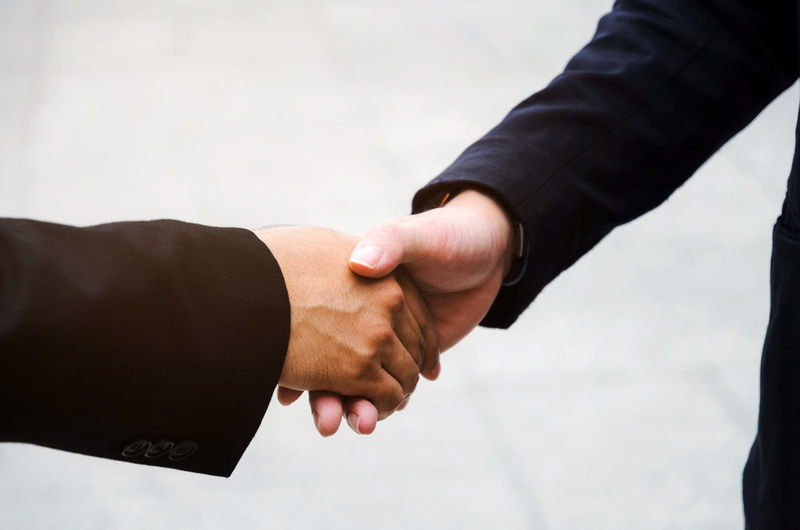 Cropped image of business coworkers shaking hands