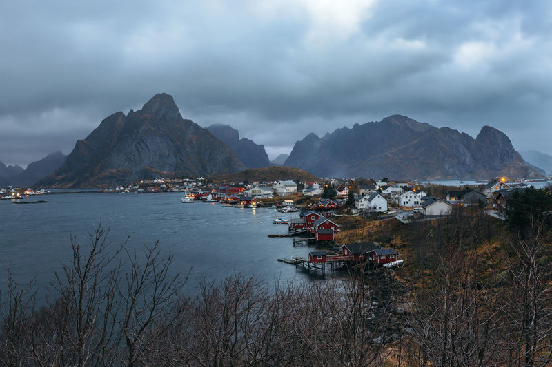 Reine is the administrative centre of Moskenes Municipality in Nordland county, Norway Mountain Water Sky Cloud - Sky Scenics - Nature Beauty In Nature Architecture Nature Mountain Range Nautical Vessel Built Structure Building No People Building Exterior Sea Transportation Day Mode Of Transportation Outdoors Bay Nordland County Lofoten Reine Moskenes Landscape
