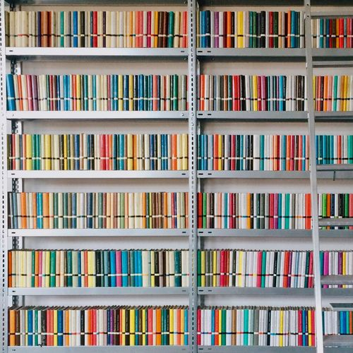Full frame image of books arranged on shelves