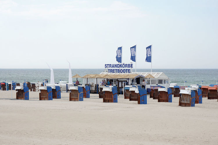 Baltic Sea Beach Beach Chairs Day Dull Empty For Rent Germany Off Season Outdoors Poor Weather Pre-season Roofed Wicker Beach Chair Rostock Sand Sea Shore Strandkorb Strandkörbe Summer Travel Destinations Vacations Warnemünde Water