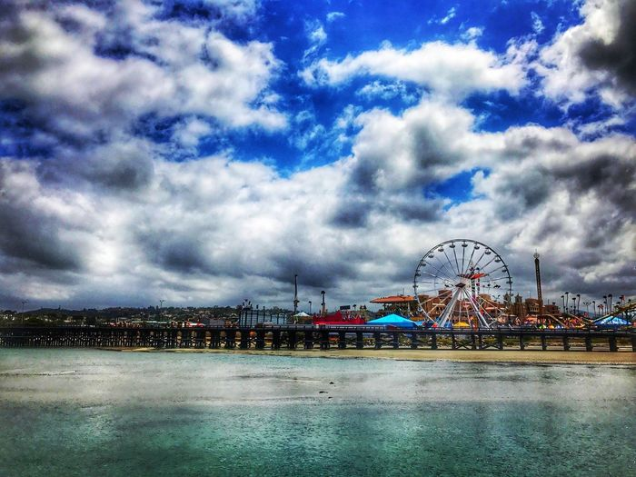 The back side of the fair EyeEmNewHere Pier San Diego Blue Sky Bluesky Calm Water Clouds Fair Faris Wheel Fluffy First Eyeem Photo
