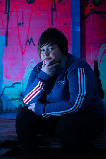 Portrait of teenage girl drinking outdoors