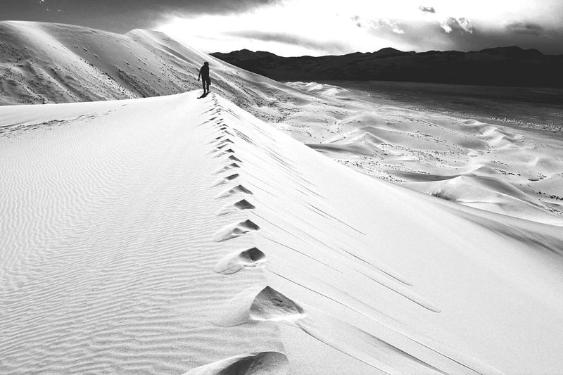 Person walking at eureka valley sand dunes