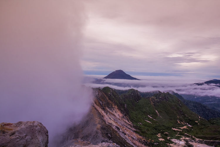 Gunung Sinabung Volcano Cloud Sinabung Sunlight Active Beauty In Nature Day Erupting Fog Forest Geology Gunung Haze Landscape Mist Mount Mountain Mountain Range Nature No People Outdoors Physical Geography Power In Nature Scenics Sibayak Sky Sunrise Tranquil Scene Tranquility Volcanic Landscape Volcano