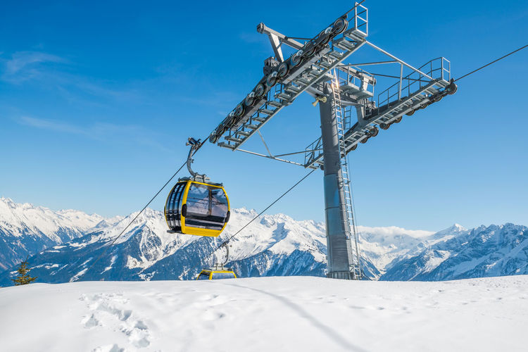 Cable ski lifts in Mayrhofen ski resort - Zillertal region, Austria Alps Austria Blue Sky White Clouds Cable Car Cableway Growth Lanscape Mayrhofen Mountain No People Outdoors People Relaxing Ski Ski Chair Ski Lift Shots Ski Resort  Sleeping Snowboarding Tirol