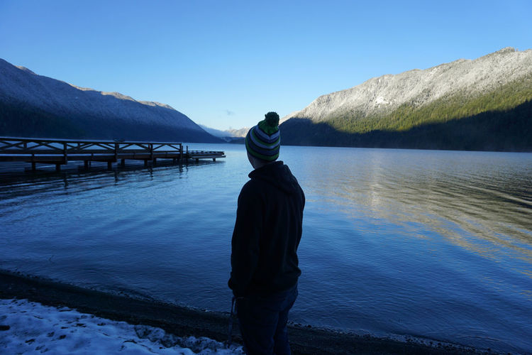 Lake Crescent, Olympic National Park-Washington. Clallam County, Washington, United States Lake Crescent, Washington. Shades Of Winter Beauty In Nature Blue Casual Clothing Clear Sky Day Full Length Leisure Activity Lifestyles Men Mountain Mountain Range Nature One Person Outdoors Real People Rear View Scenics Sky Standing Tranquil Scene Tranquility Water Shades Of Winter The Great Outdoors - 2018 EyeEm Awards