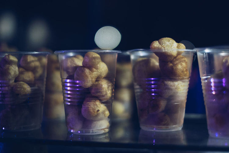 Street food: Fish balls in plastic cups Arranged Bokeh Crunchy Diet Display Drinking Glass Exotic Fish Balls Food Food And Drink Food Cart Freshness Merchandise Night Photography Order Philippines Plastic Cup Selective Focus Street Food Street Photography Table Unhealthy Eating Vendor