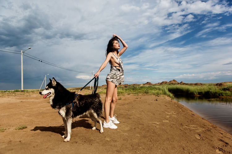 Beach Beachphotography Beautiful Woman Casual Clothing Dog Girl Nature One Animal One Person Sky Water Young Adult Young Women
