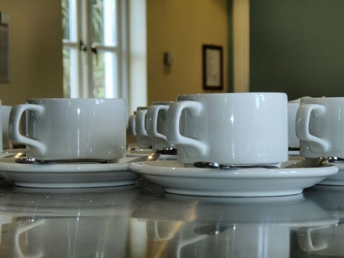 Tea Cups Arranged On Table