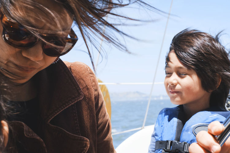 Mother and child sailing a boat, headshot Bay Berkeley Marina Boat Bonding Boy California Childhood Day Elementary Age Family Family With One Child Leisure Activity Lifestyles Love Marina Mother Ocean Outdoors Real People Sailing Smiling Togetherness Women Young Adult Young Women Let's Go. Together.
