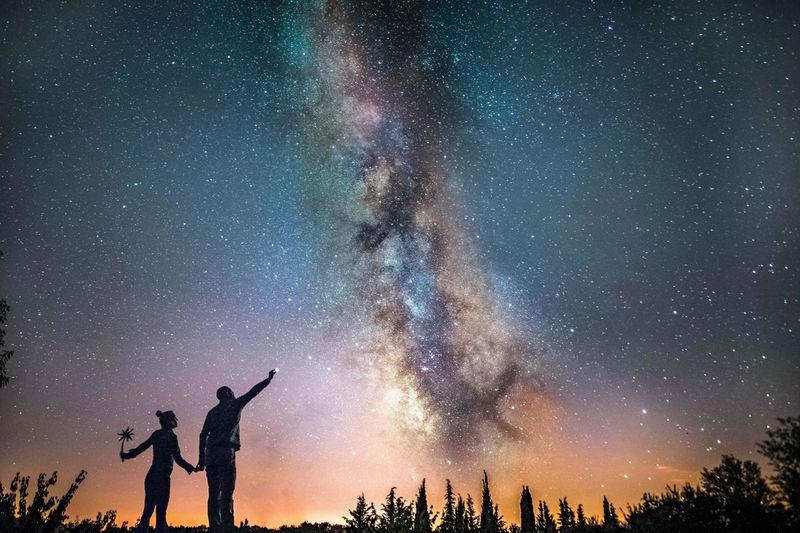 Catch a star Beauty In Nature Outdoors Milky Way People Space And Astronomy Night Astronomy Two People Silhouette Star - Space Sky