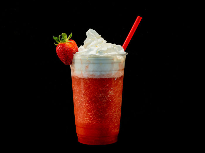 Close-up of red drink against black background