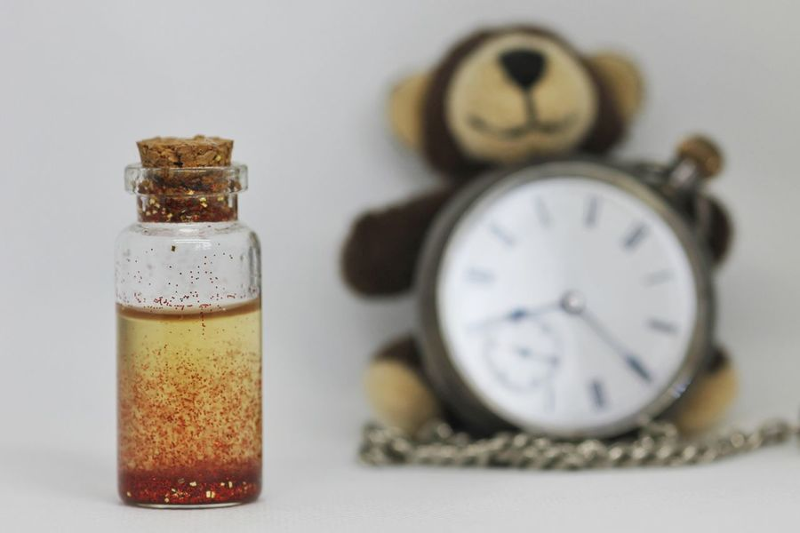 Time is running out Teddy Teddy Bear Teddybear Toy Toys Stuffed Toy Peluche Clock Bottle Time Time To Reflect Decisions Decision Making Potion Magic Time Out Running Time Childhood Time Is Running Out Timeless Reflection Bottle Indoors  Studio Shot No People Clock Close-up White Background Time Clock Face