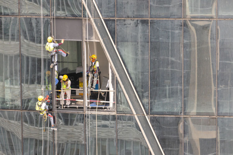 Window washers on building