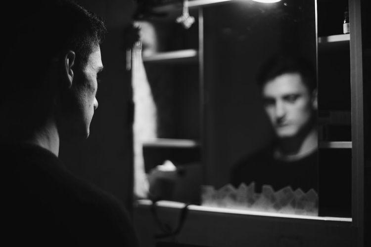 Man Reflecting In Mirror