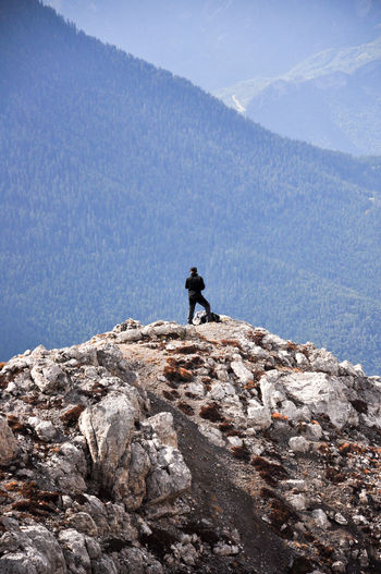 Man on rock against mountain