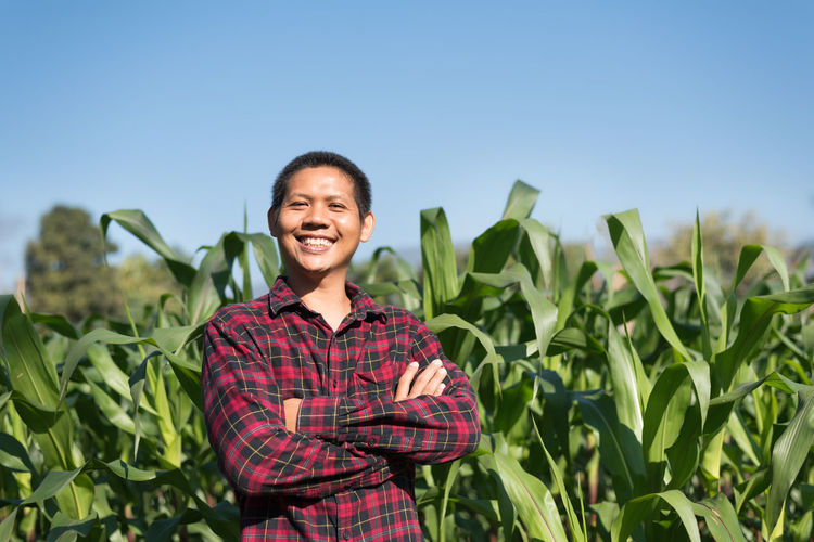 Portrait of Asian farmer smiling in corn field, Thailand Man Farmer Corn Field Agriculture ASIA Asian  Thai Thailand Smart Young Cultivation Crop  Cereal Outdoor Proud Rural Plant Smiling Happy Arms Crossed Standing Harvest Farm Farming Countryside Nature Organic People person Portrait Male Maize One Tropical One Person Front View Growth Happiness Looking At Camera Day Outdoors